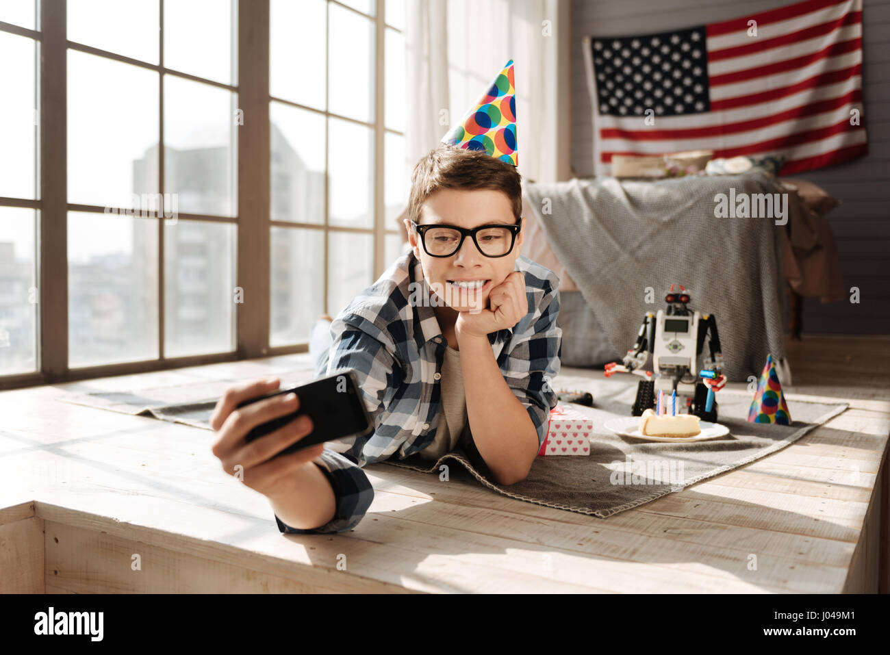 Attractive young male person having birthday party - Stock Image