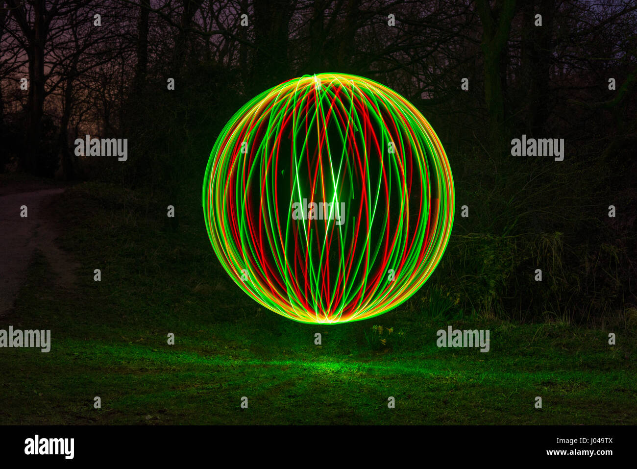 A sphere created using light painting. A special photographic technique - Stock Image