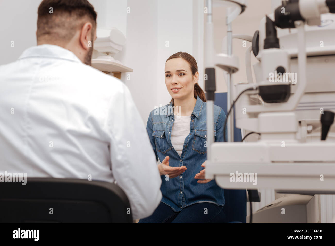 Nice good looking woman speaking with her ophthalmologist Stock Photo