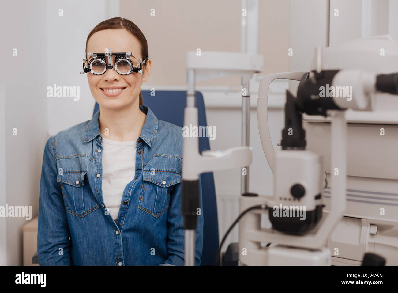Delighted happy woman wearing eye test glasses - Stock Image