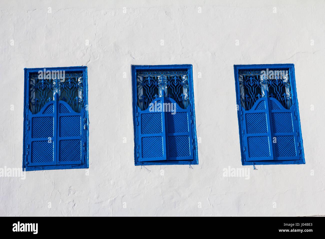 Blue shuttered windows in Sidi Bou Said, Tunisia. - Stock Image