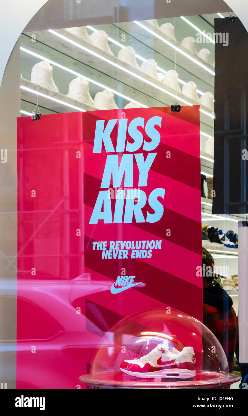 Nike poster message in the window of a Nike store in New York City - Stock Image