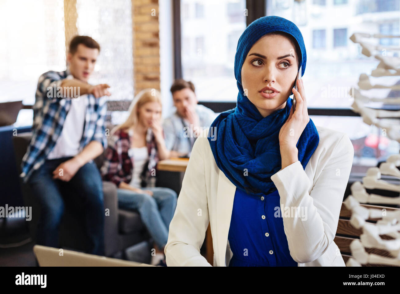 PlGroup of students abusing pleasant muslim female student - Stock Image