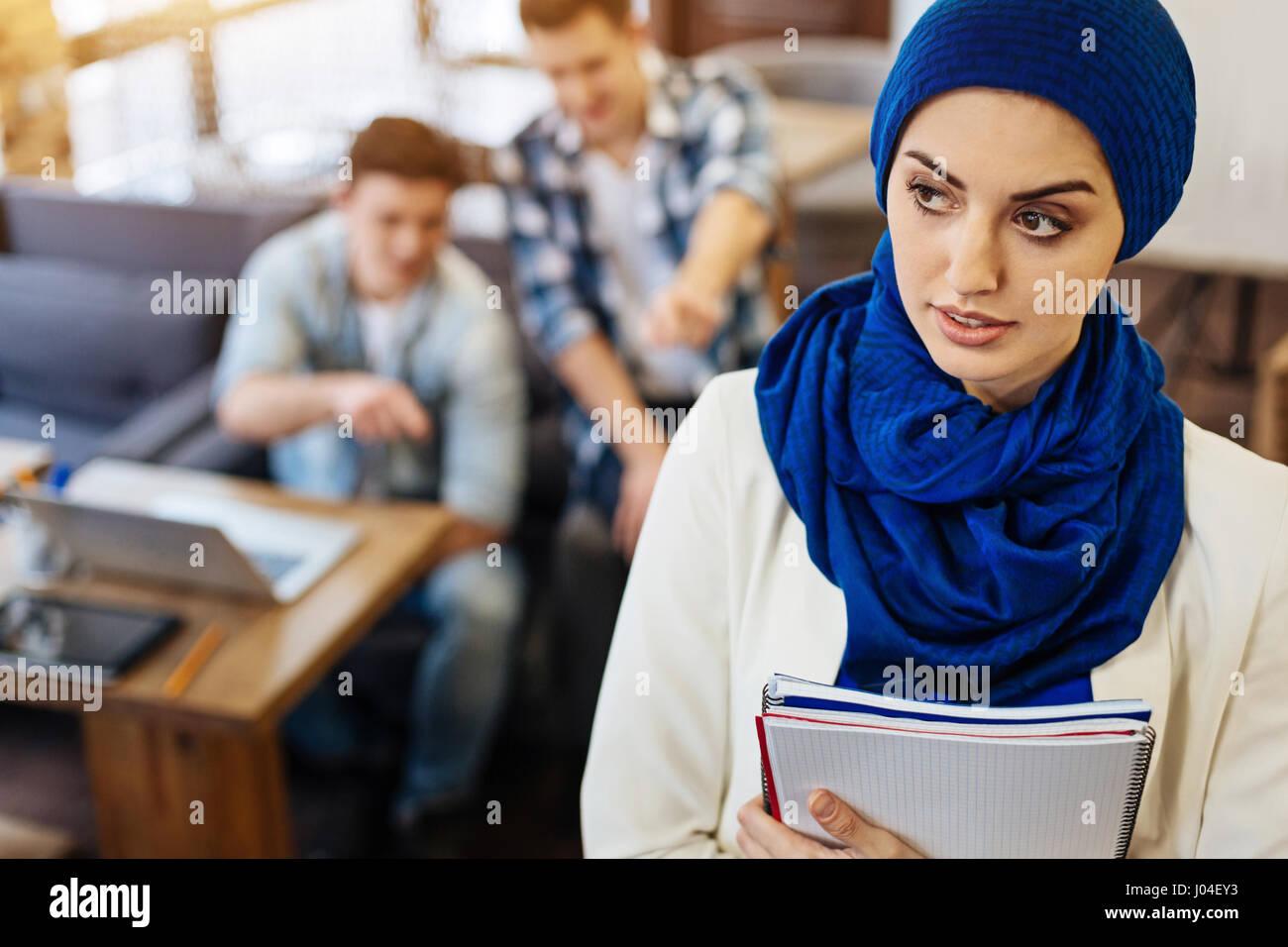 Pleasant beautiful muslim student being abused - Stock Image