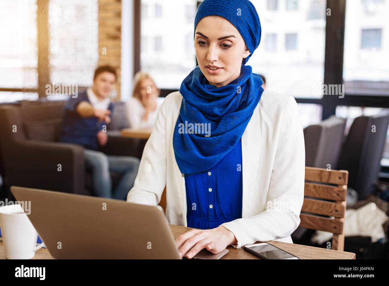 Pleasant muslim businesswoman feeling injustice from the society - Stock Image