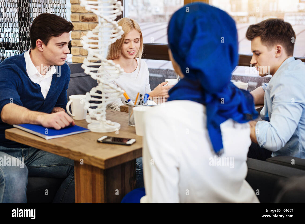 Group of students preparing project work in genetics - Stock Image