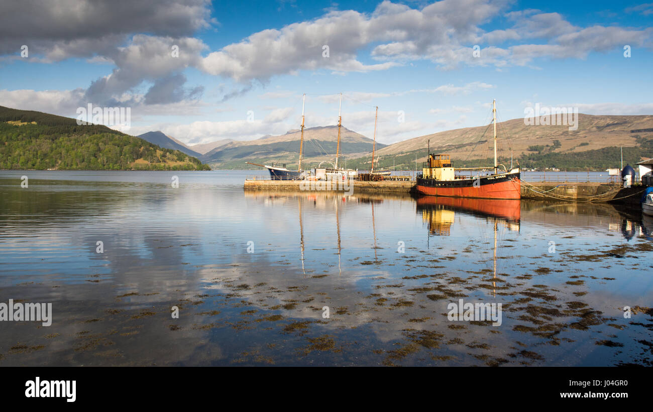 The Vital Spark, a famous 'Clyde Puffer' boat, is moored at Inveraray Pier in Loch Fyne in the West Highlands - Stock Image