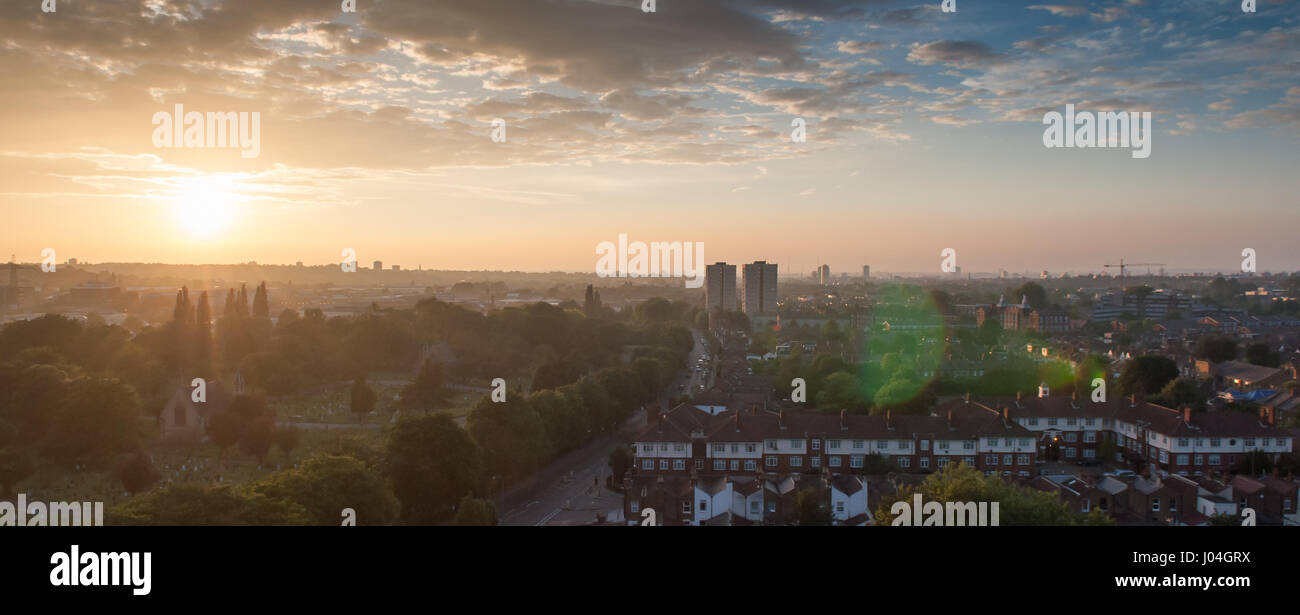 Sunset over terraced houses and the Lambeth Cemetery at Blackshaw Road in Tooting, south west London. - Stock Image