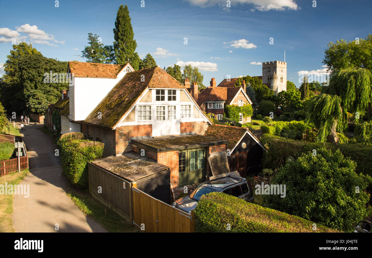 Reading, England, UK - August 29, 2016: Traditional cottages and parish church beside the River Thames in the village - Stock Image