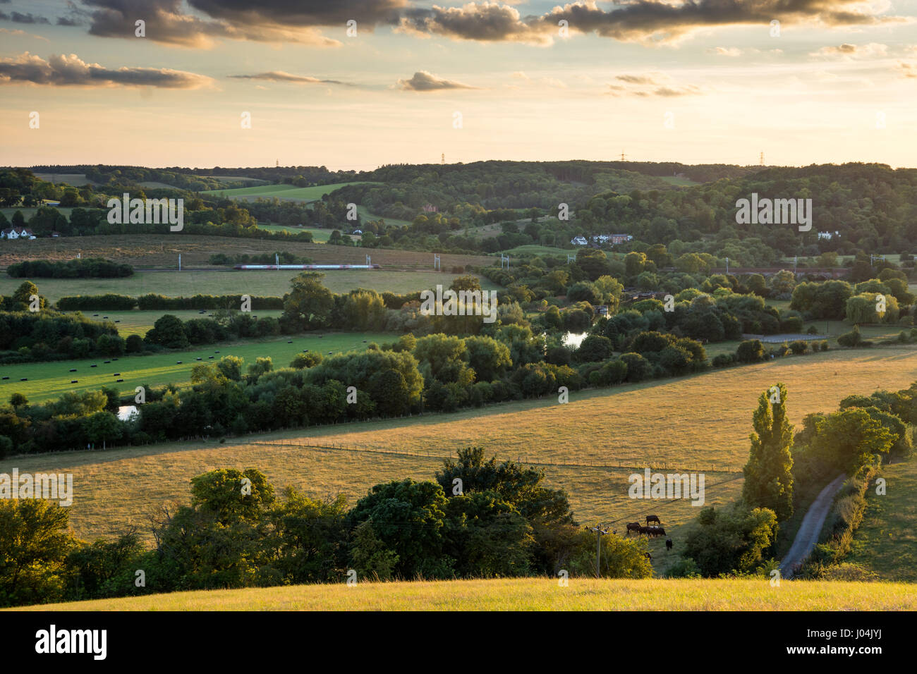 Reading, England, UK - August 29, 2016: A Crosscountry Voyager train at Goring Gap in Berkshire, under new electrification - Stock Image