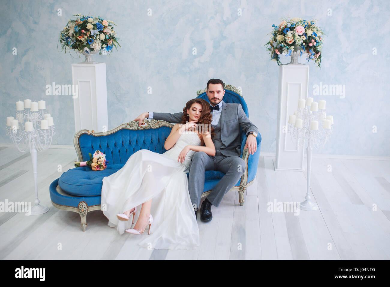 Groom Bride Sitting On Sofa Stock Photos & Groom Bride Sitting On ...