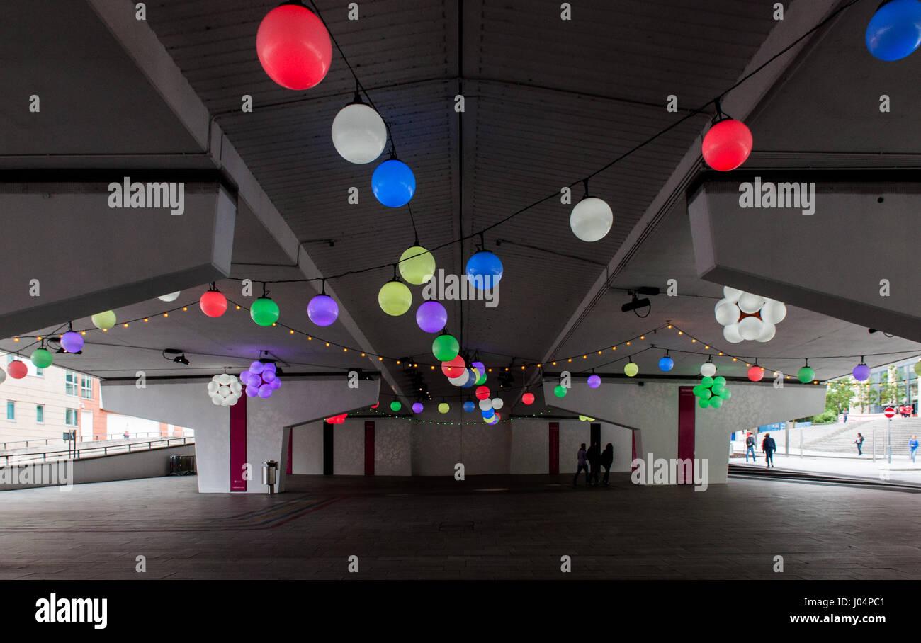 Birmingham, England, UK - June 23, 2012: Colourful lanterns illuminate the dark underpasses beneath the Queensway - Stock Image