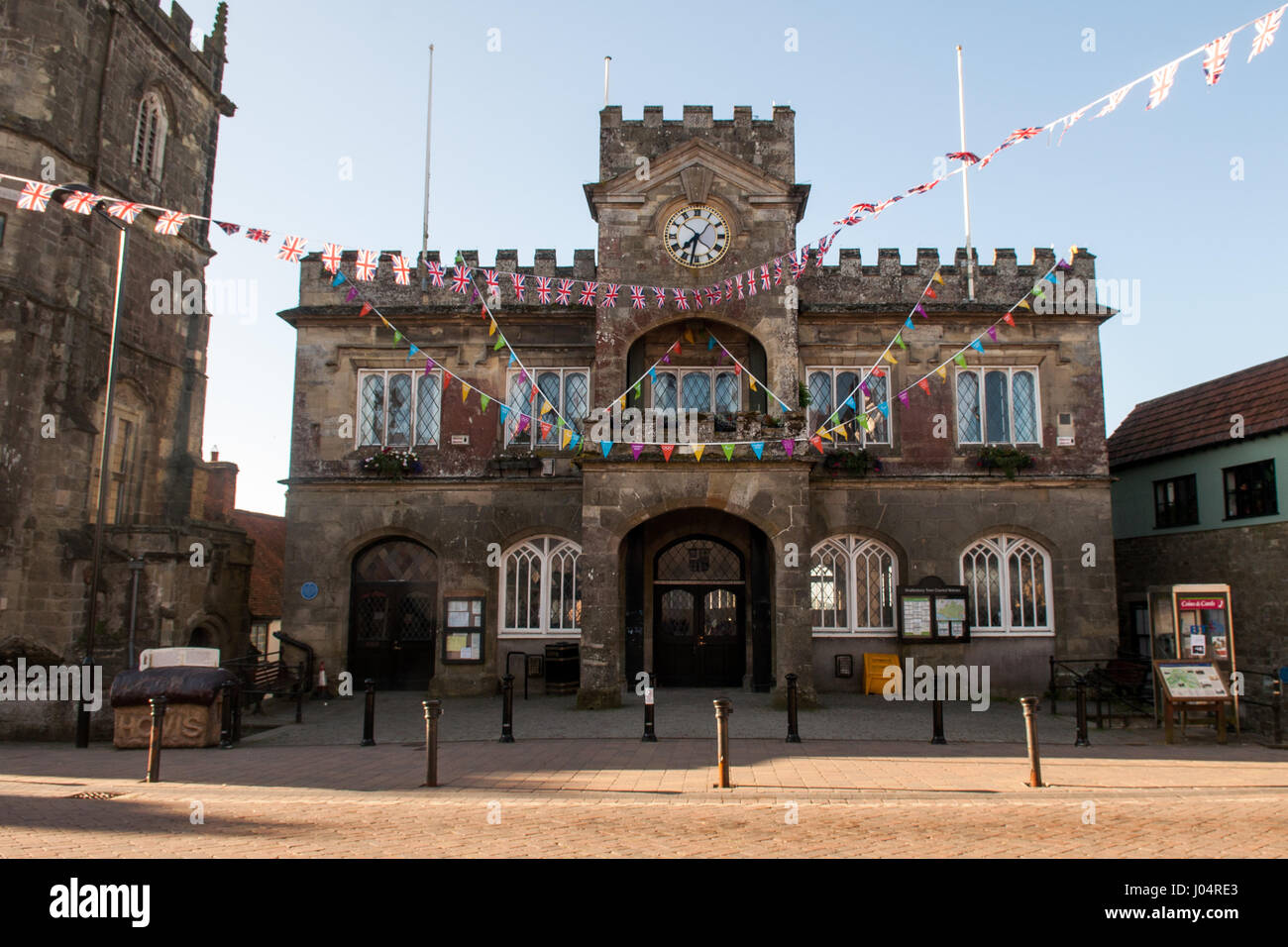 Shaftesbury, England, UK - June 28, 2012: Bunting decorates the castellated stone town hall of Shaftesbury in Dorset - Stock Image