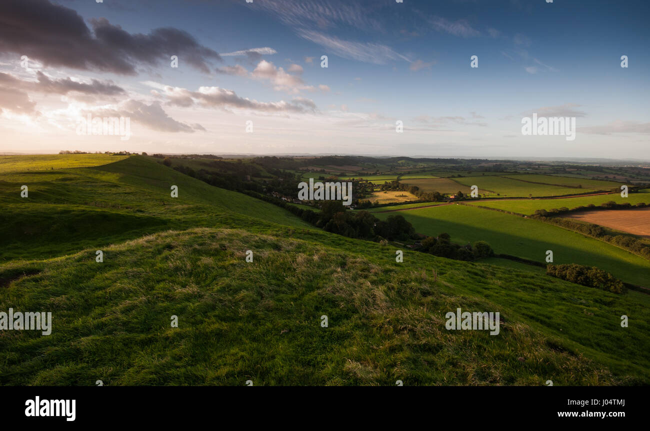 Sunrise over Corton Denham village and Corton Beacon hill, on the agricultural landscape of South Somerset. - Stock Image