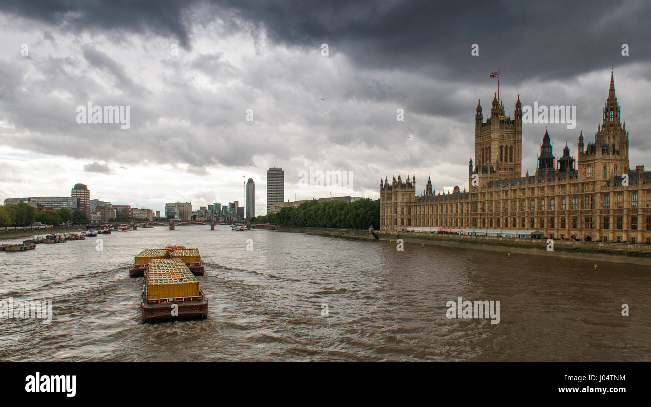 London, England, UK - October 5, 2012: Freight barges carrying containerised waste and recycling are towed on the - Stock Image