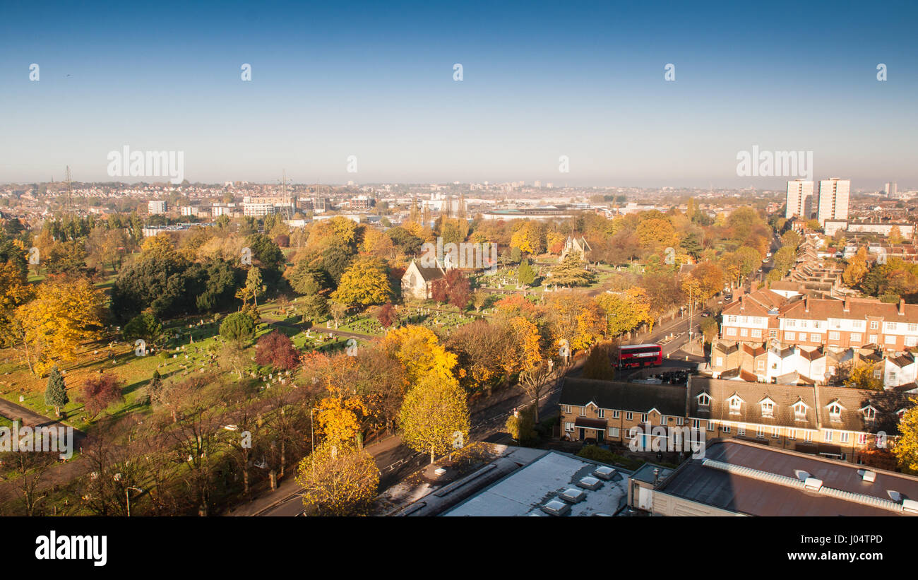 London, England, UK - November 11, 2012: Trees display autumn colours in the Lambeth Cemetery on Blackshaw Road - Stock Image