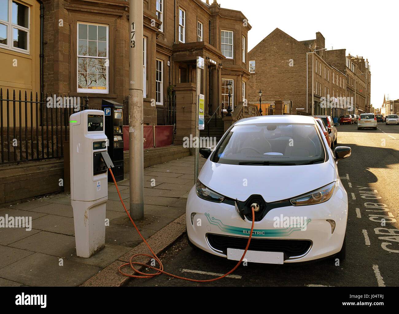 An electric car, from the city's Car Club scheme, being charged on Perth Road, Dundee - Stock Image