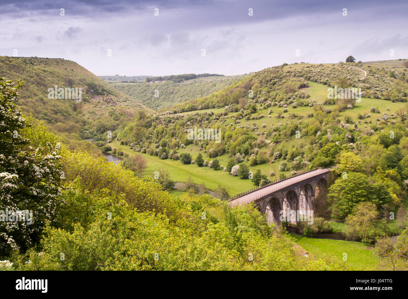 The Victorian Midland Railway Headstone Viaduct, now part of the Monsal Trail cycleway, in Monsal Dale in England's - Stock Image