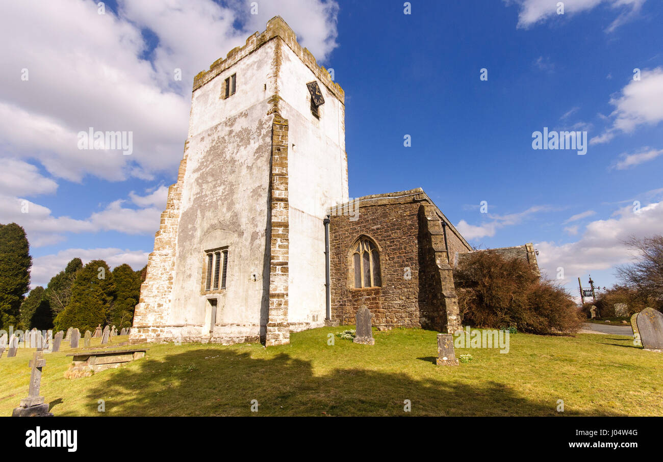 Cumbria, England - March 30, 2013: The whitewashed church tower in the village of Orton in the Eden district of Stock Photo