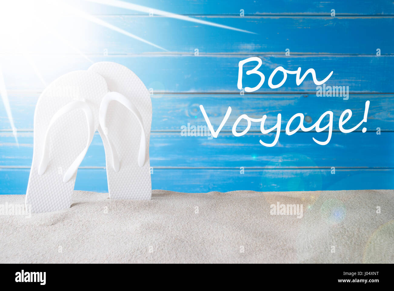 French text bon voyage means good trip sunny summer greeting card french text bon voyage means good trip sunny summer greeting card with sand and flip flops blue vintage and shabby chic wooden background m4hsunfo