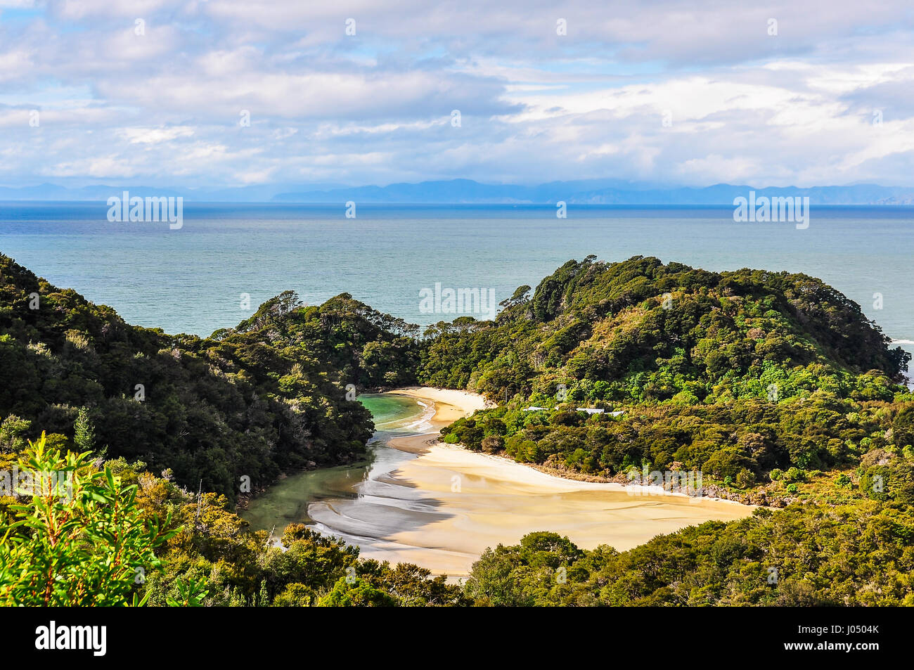Secluded Frenchman Bay in the Abel Tasman National Park in New Zealand - Stock Image
