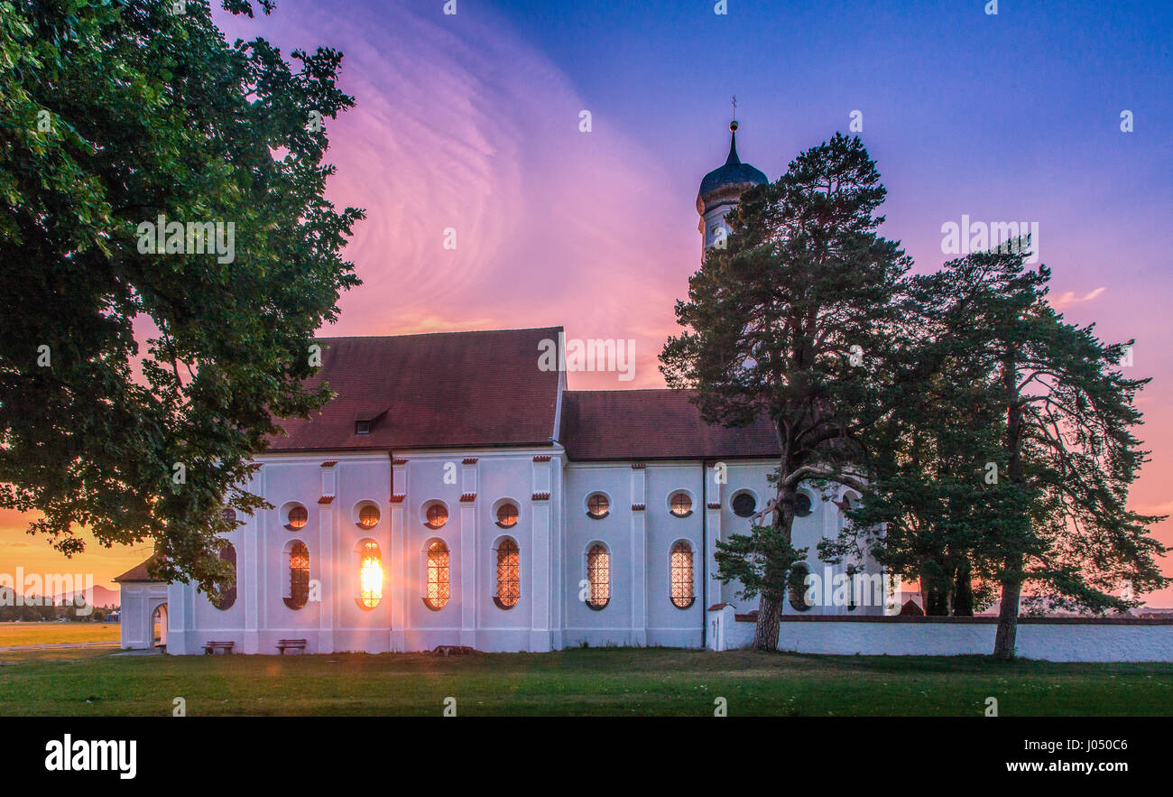 Panoramic view of famous St. Coloman church near Fussen in beautiful evening light at sunset in summer, Schwangau, - Stock Image