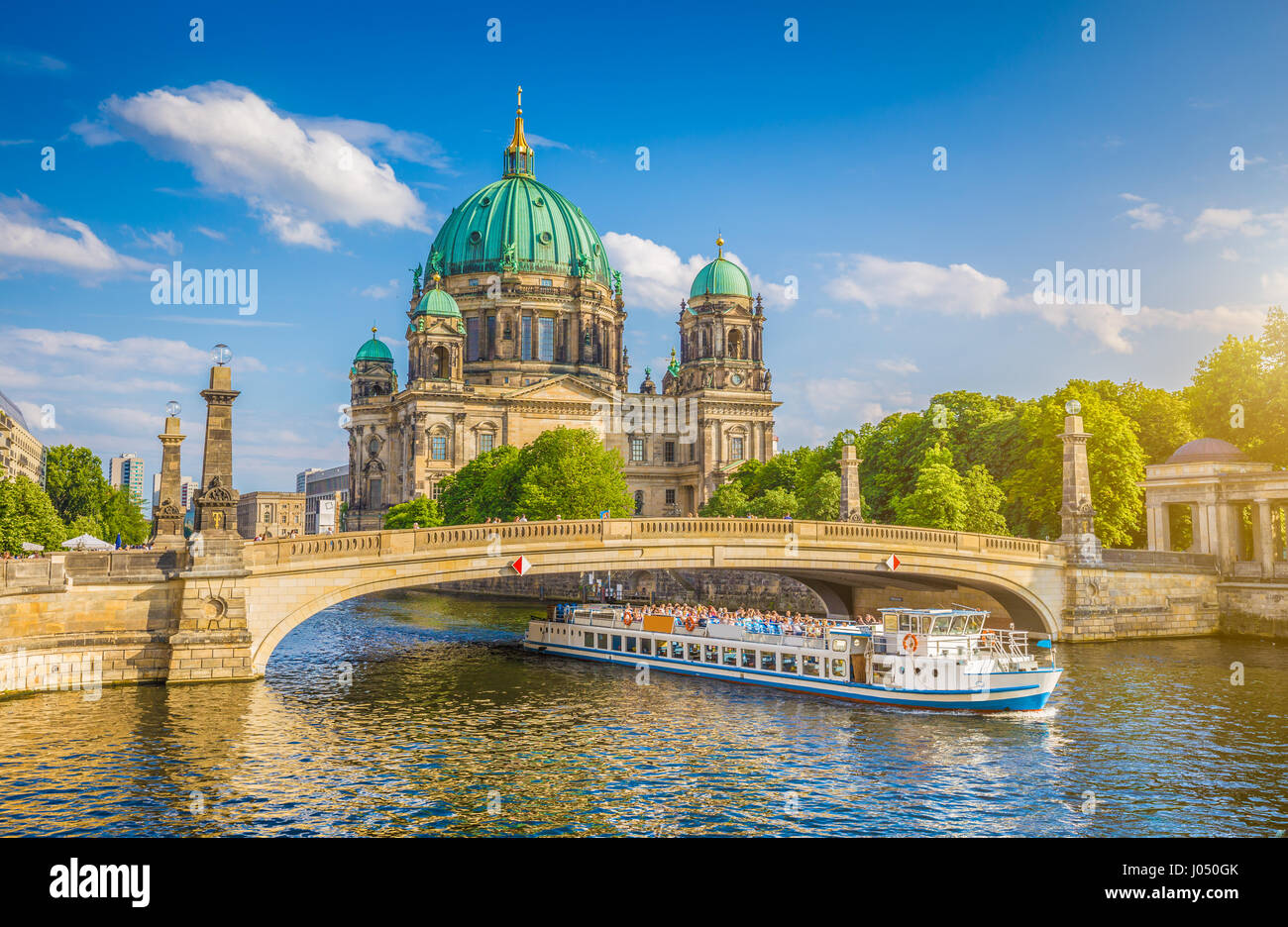 Beautiful view of historic Berlin Cathedral (Berliner Dom) at famous Museum Island with ship passing Friedrichsbrucke - Stock Image