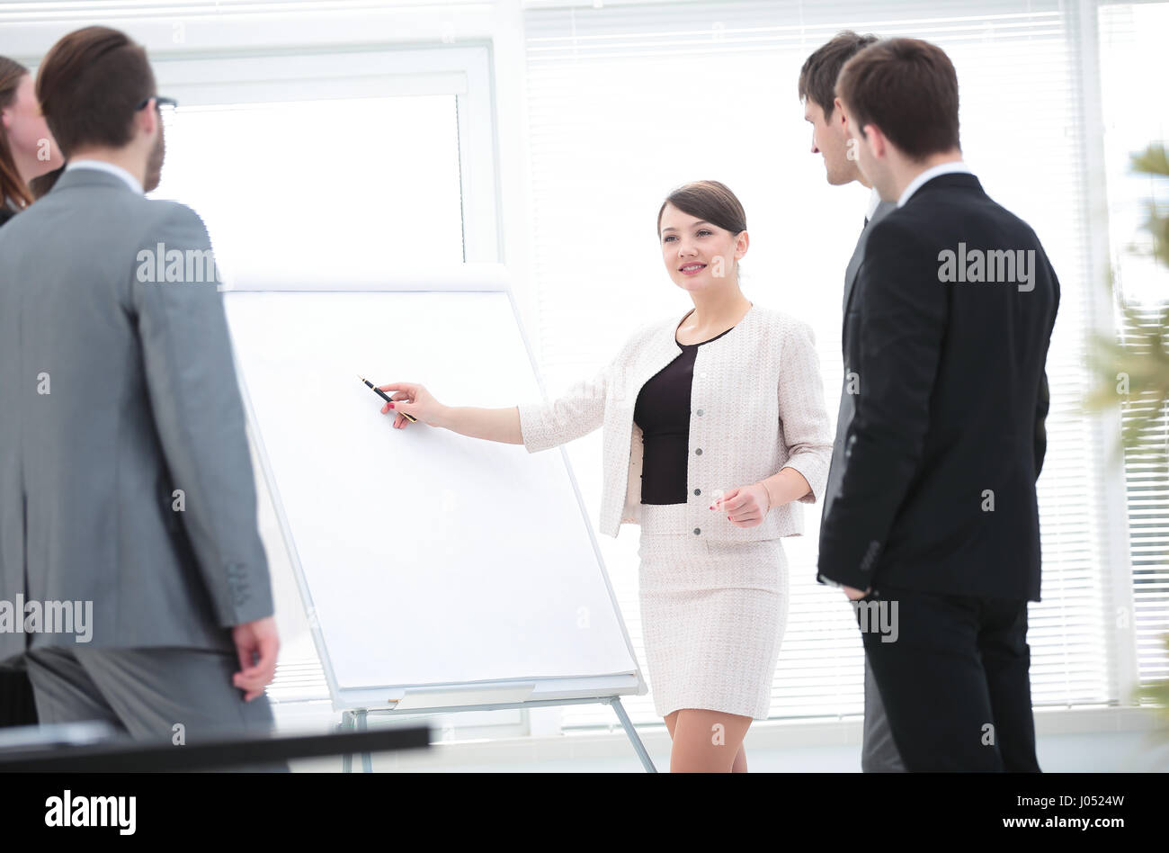 Business woman making a business presentation to a group - Stock Image