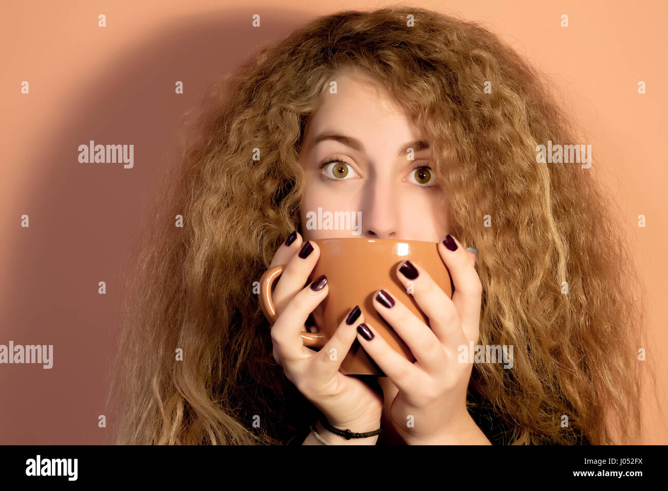 Beautiful closeup of a blond woman drinking coffee Stock Photo