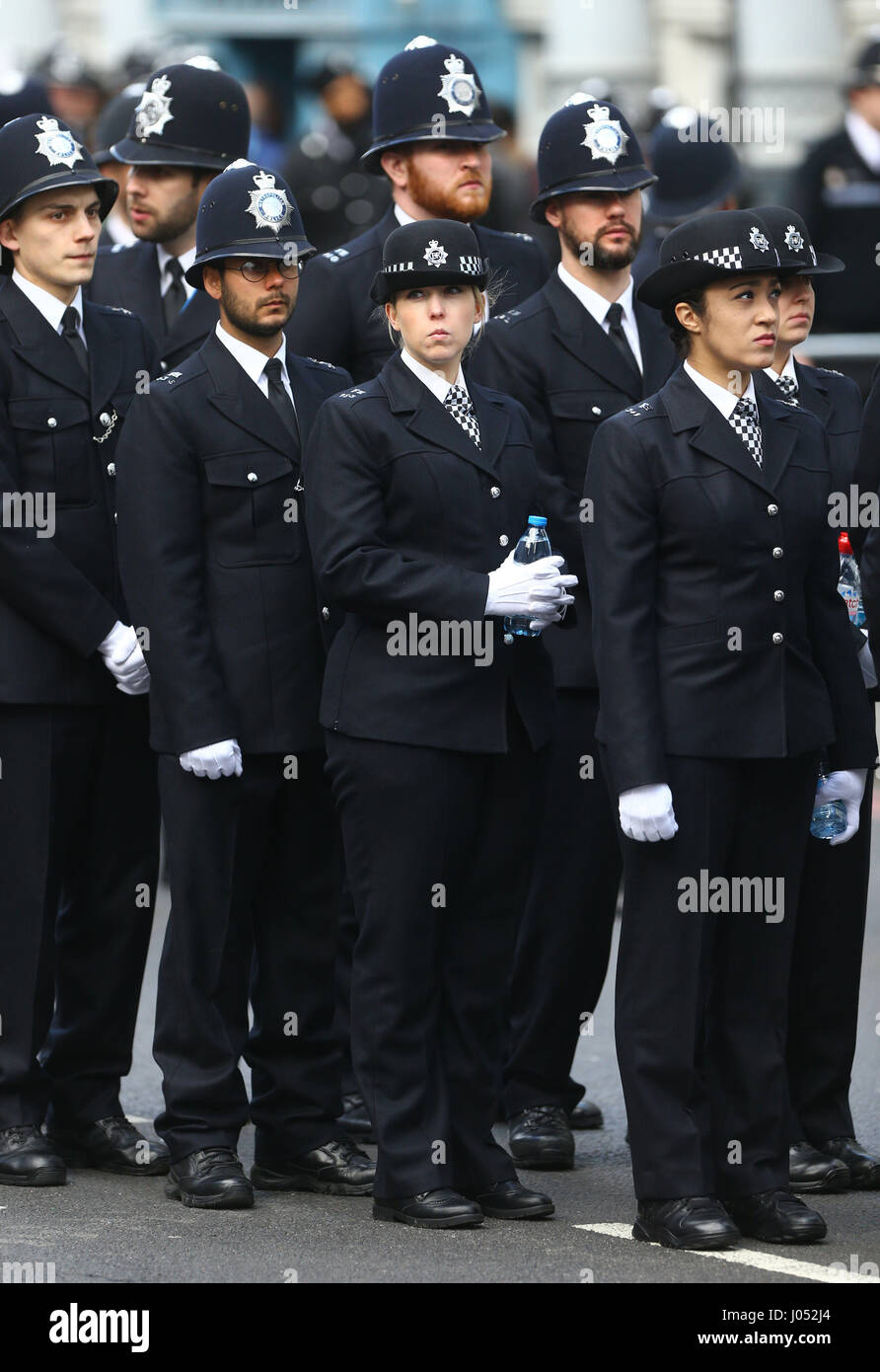 Police officers are positioned near Southwark Cathedral in London, before the funeral service of Pc Keith Palmer. - Stock Image