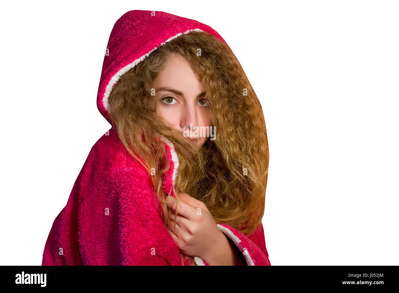 Beautiful blond haired green eyed  woman wearing a pink toweling robe - Stock Image