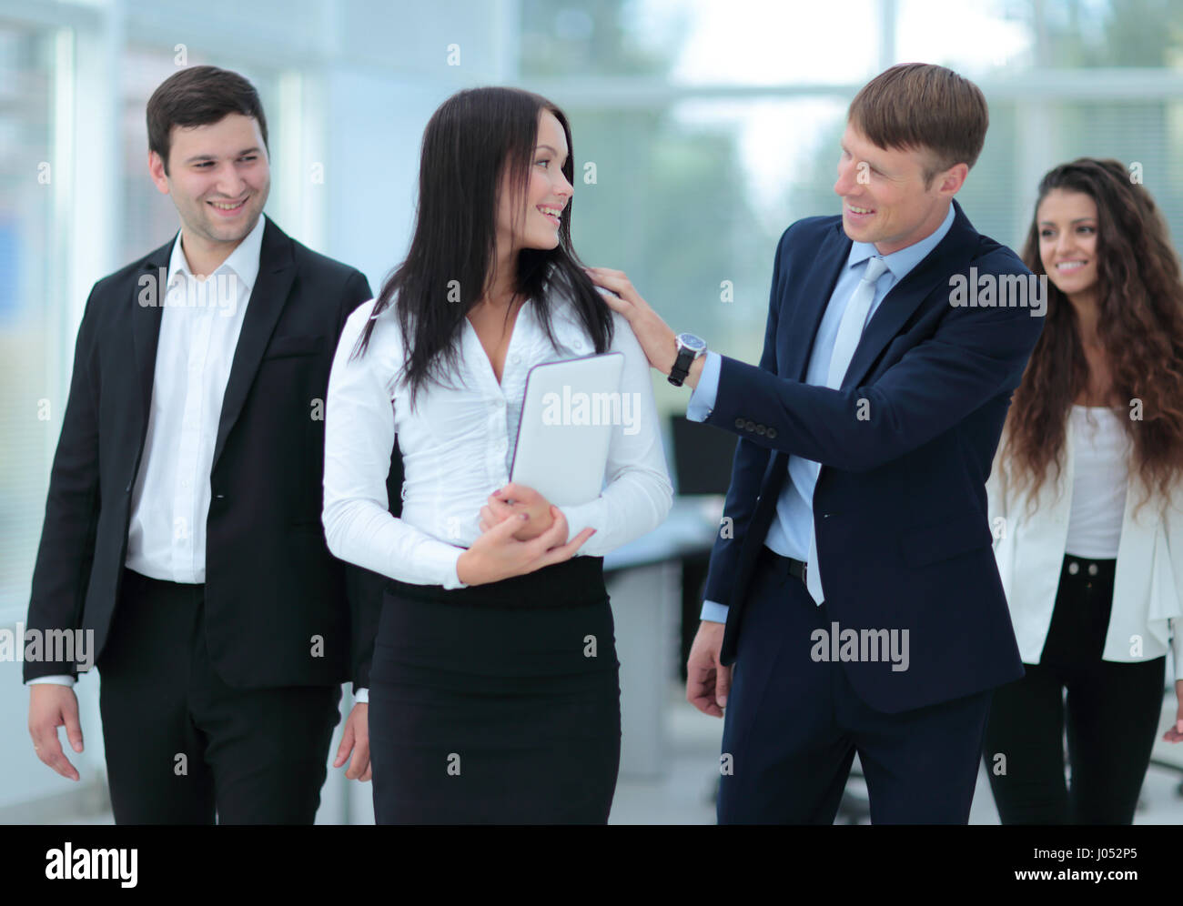 Successful team of coworkers making great meeting discussion in  - Stock Image
