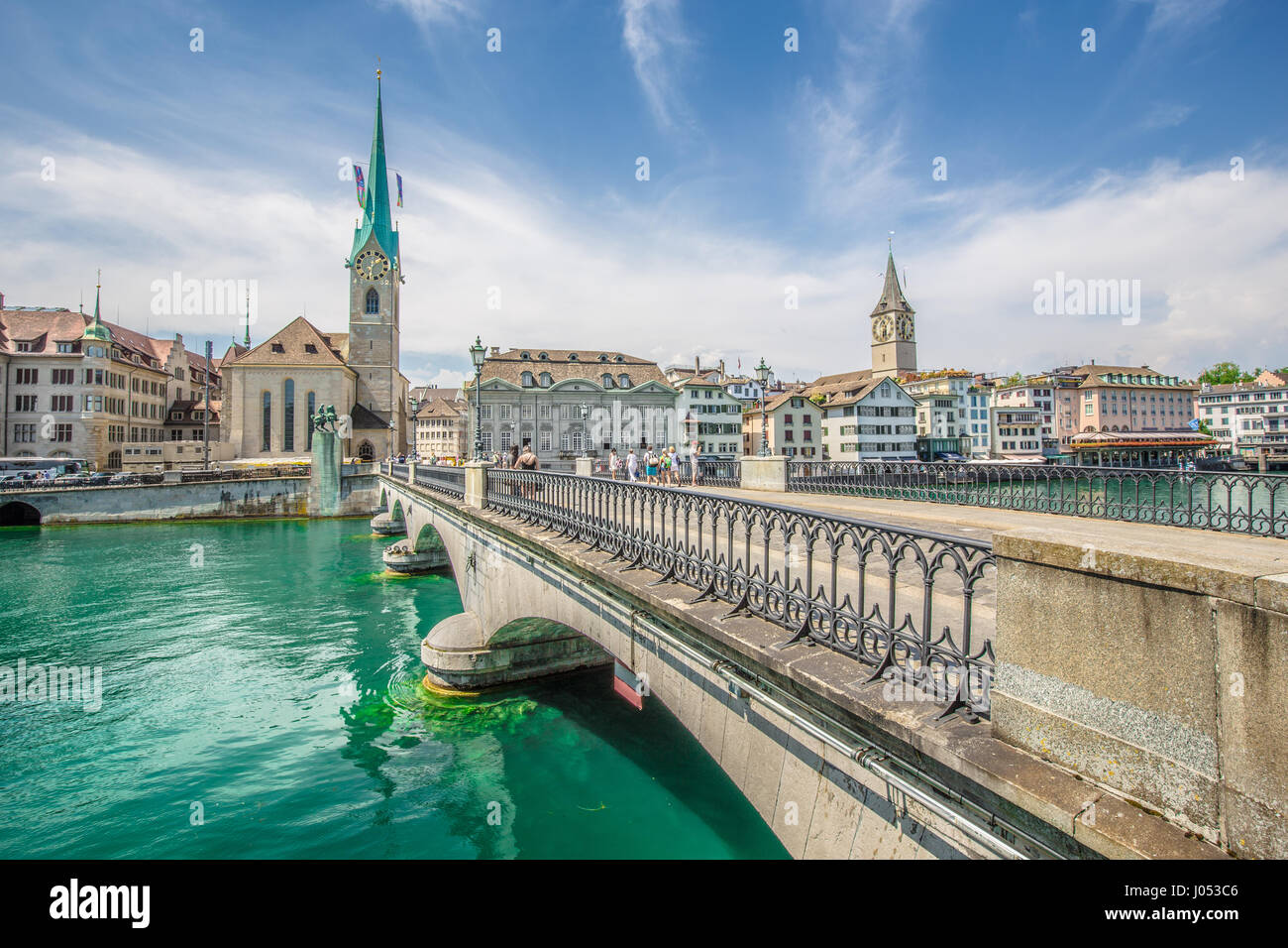 Panorama view of historic city center of Zurich with famous Fraumunster Church and Munsterbucke crossing river Limmat Stock Photo