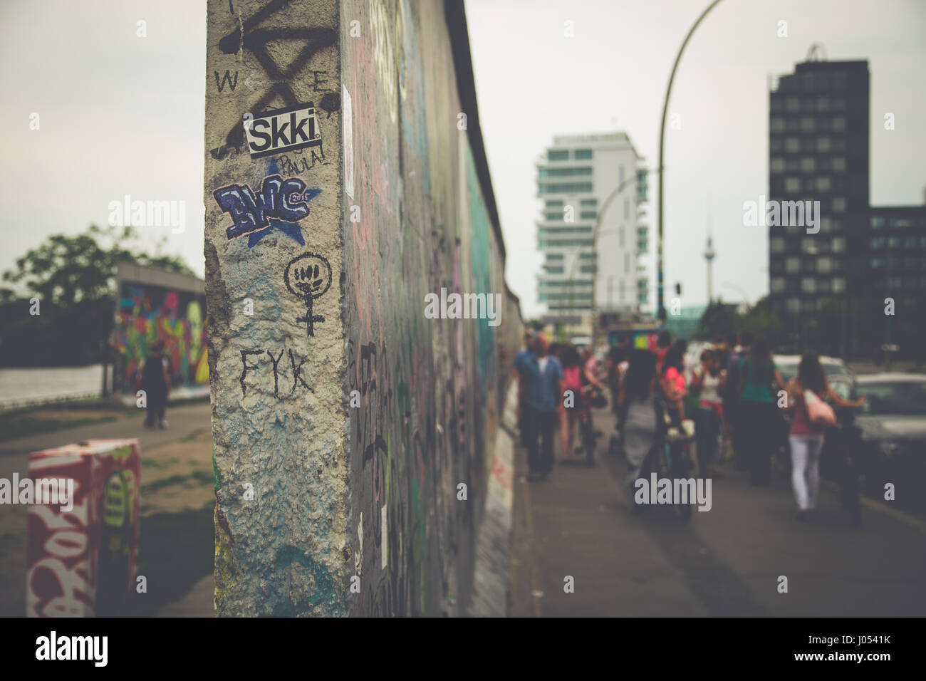 Panoramic view of famous Berlin Wall decorated with colorful graffiti street art at historic East Side Gallery on - Stock Image