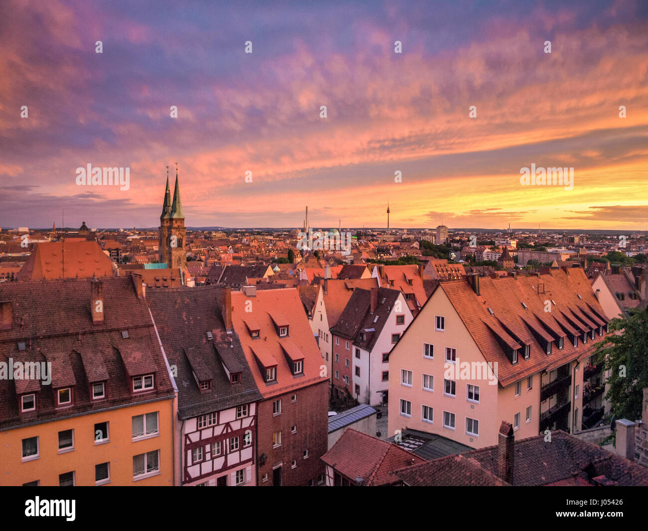 Panoramic view of the historic city of Nuremberg illuminated in beautiful golden evening light with dramatic clouds - Stock Image