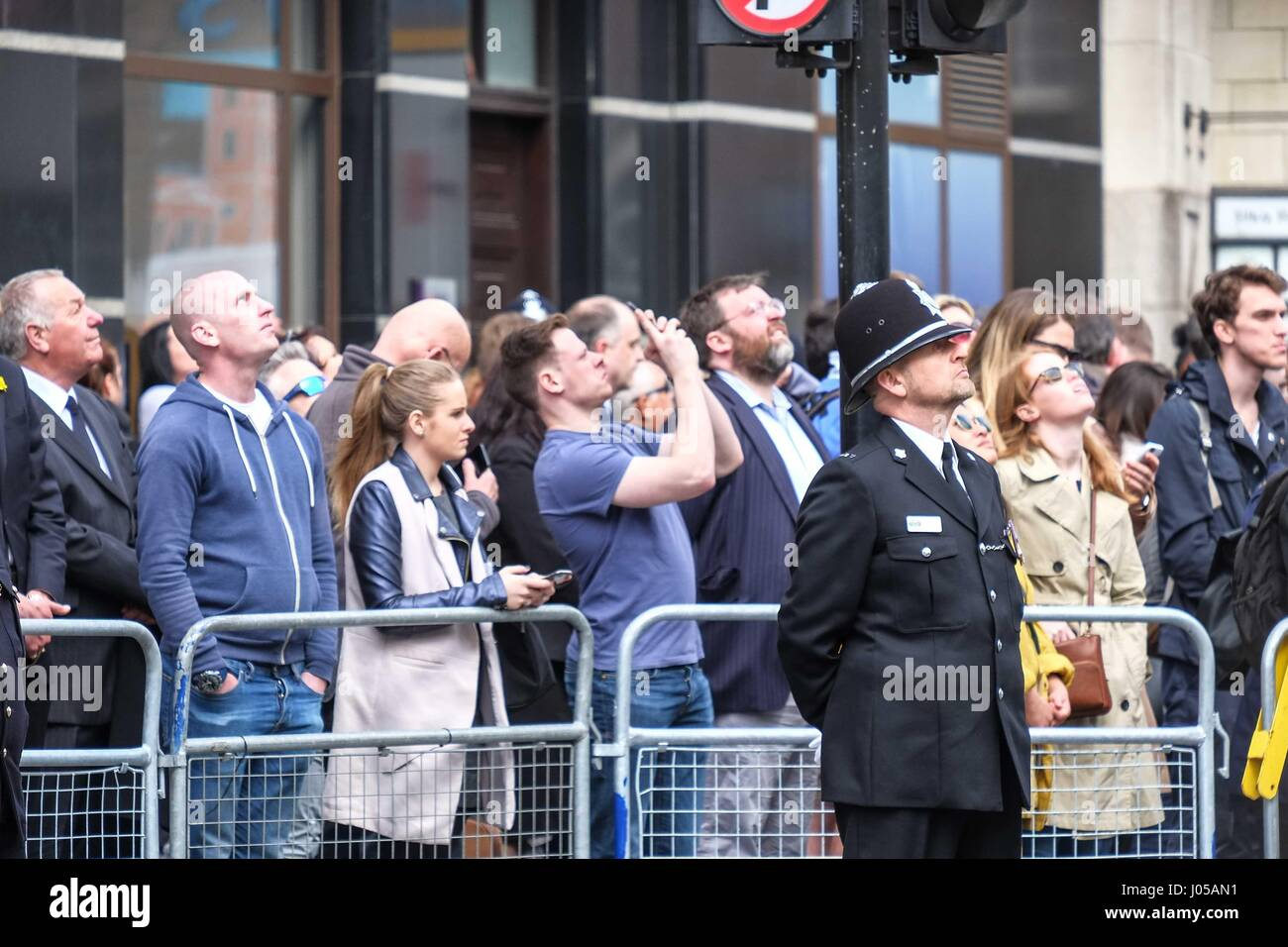 London, UK. 10th Apr, 2017. Mourners look up as Police helicopters 'bow' in honour of PC Keith Palmer PC Keith Palmer Stock Photo