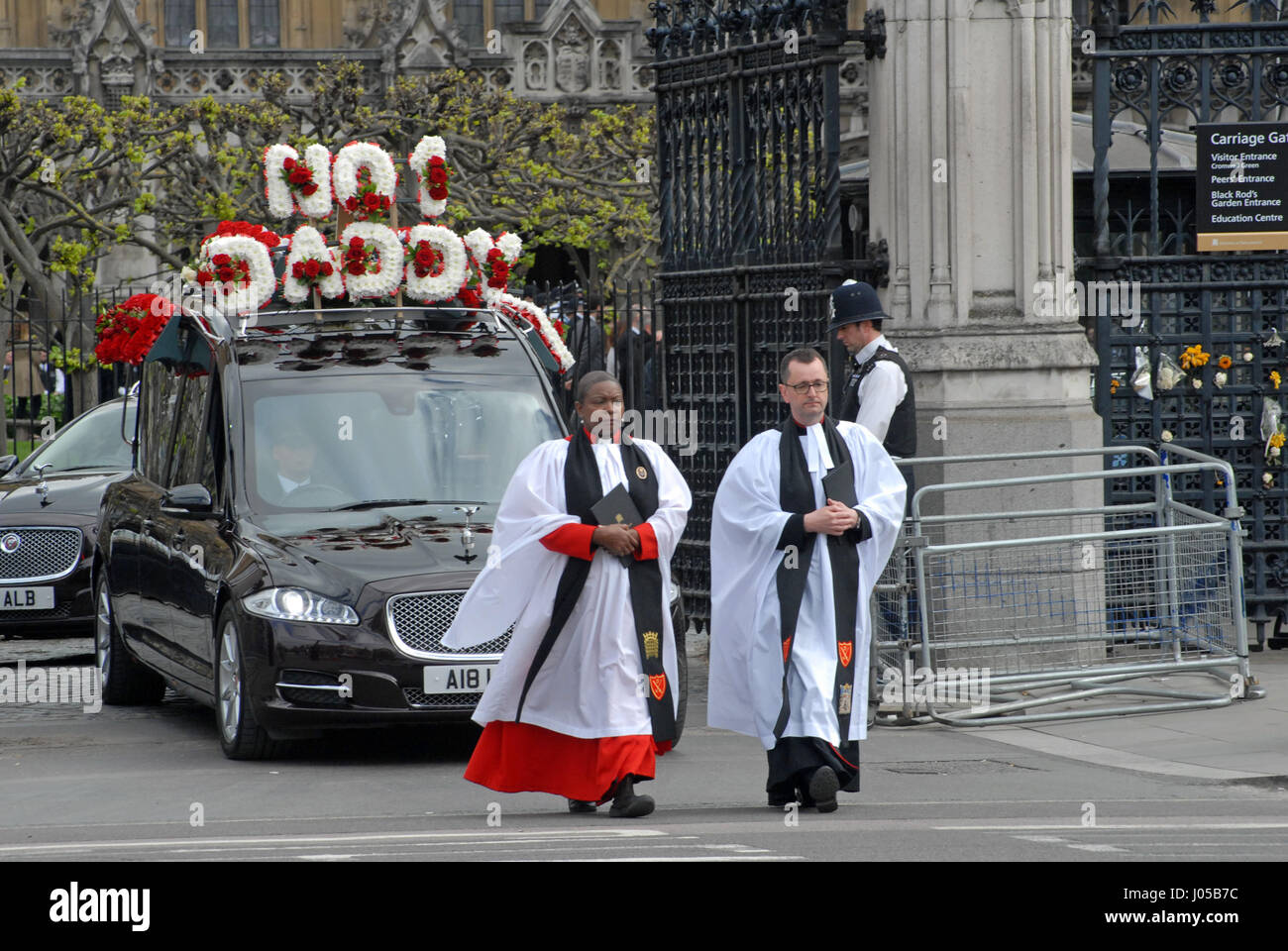 London, UK. 10th Apr, 2017. Reverend Prebendary Rose Hudson-Wilkin leads the hearse through the gates.The coffin - Stock Image