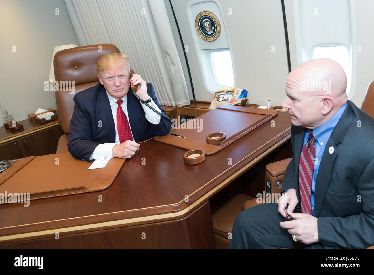 U.S President Donald Trump speaks by telephone with speaks with the commanding officers of the guided-missile destroyers - Stock Image