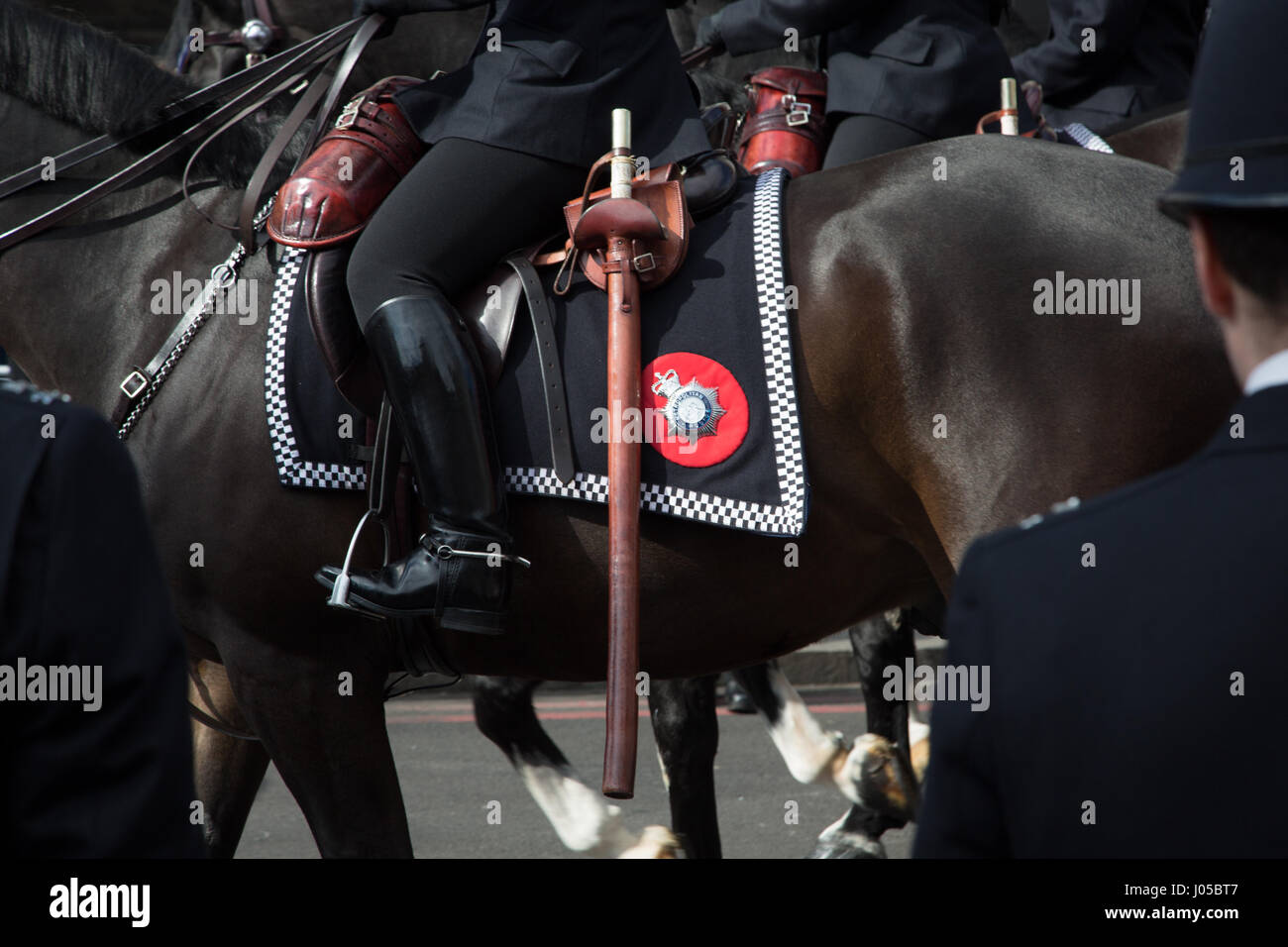 London, UK. 10th Apr, 2017. A police officer on horse back as the the coffin of PC Keith Palmer makes its way down - Stock Image