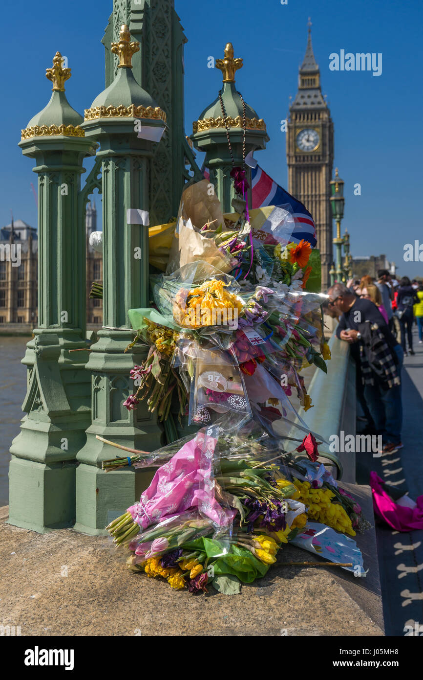 Floral Tributes, placed on Westminster Bridge, to the victims of the Westminster attack  by Khalid Masood who ran - Stock Image