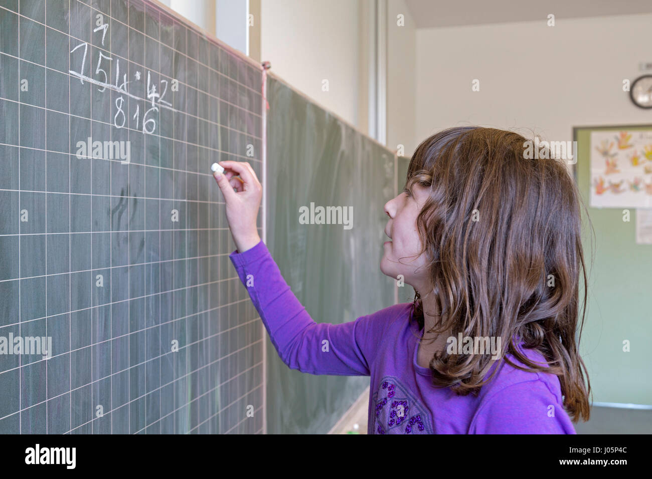 girl at primary school doing Maths, Lower Saxony, Germany - Stock Image