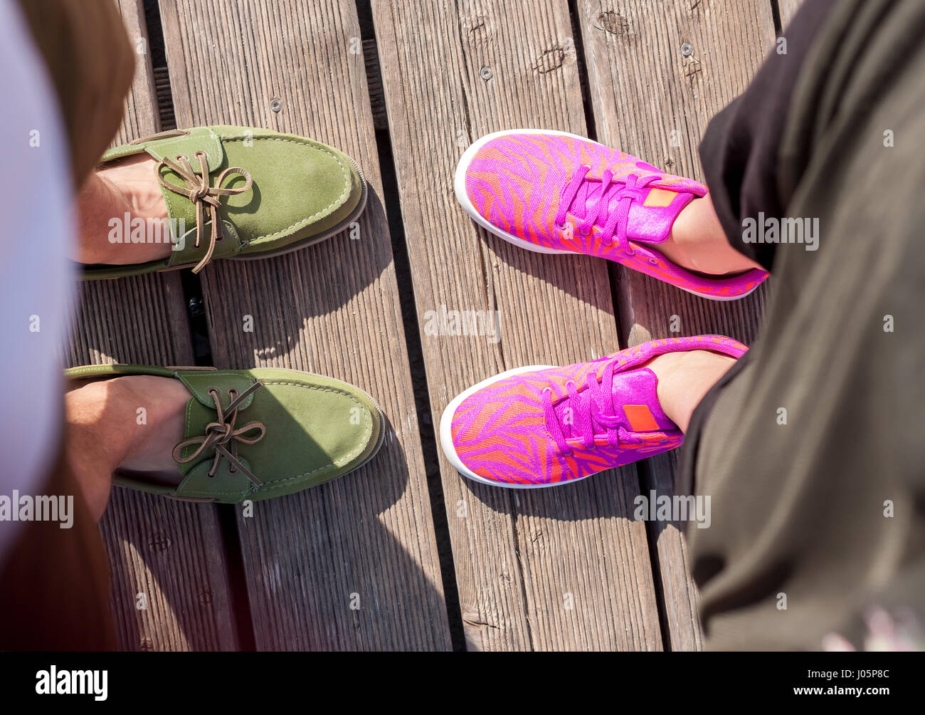 woman and man standing close feet - Stock Image