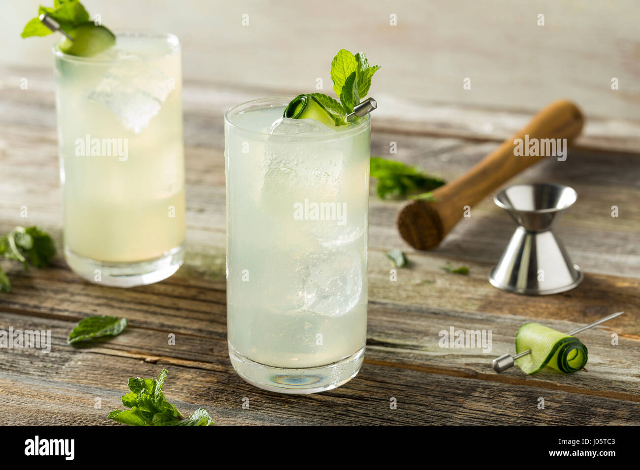 Refreshing Cucumber Gin Spritz Cocktail with Lime and Mint - Stock Image
