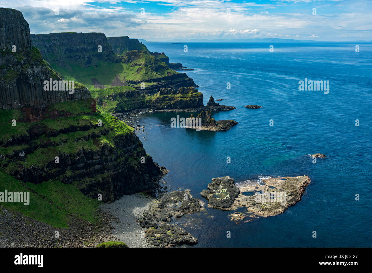 Cliff scenery looking west from Benbane Head, from the Causeway Coast footpath, County Antrim, Northern Ireland, Stock Photo