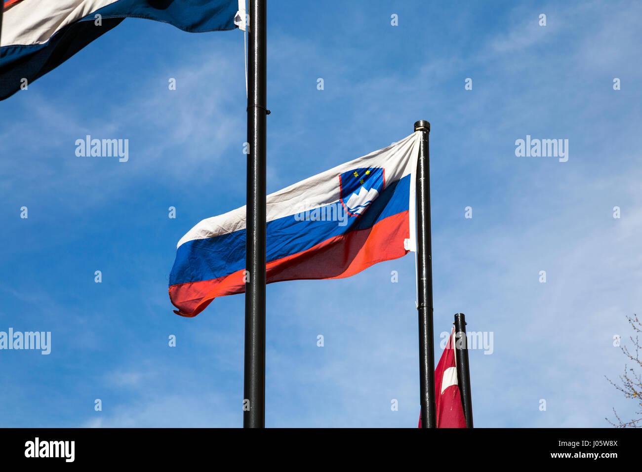 Slovenian flag on a flagpole outside - Stock Image