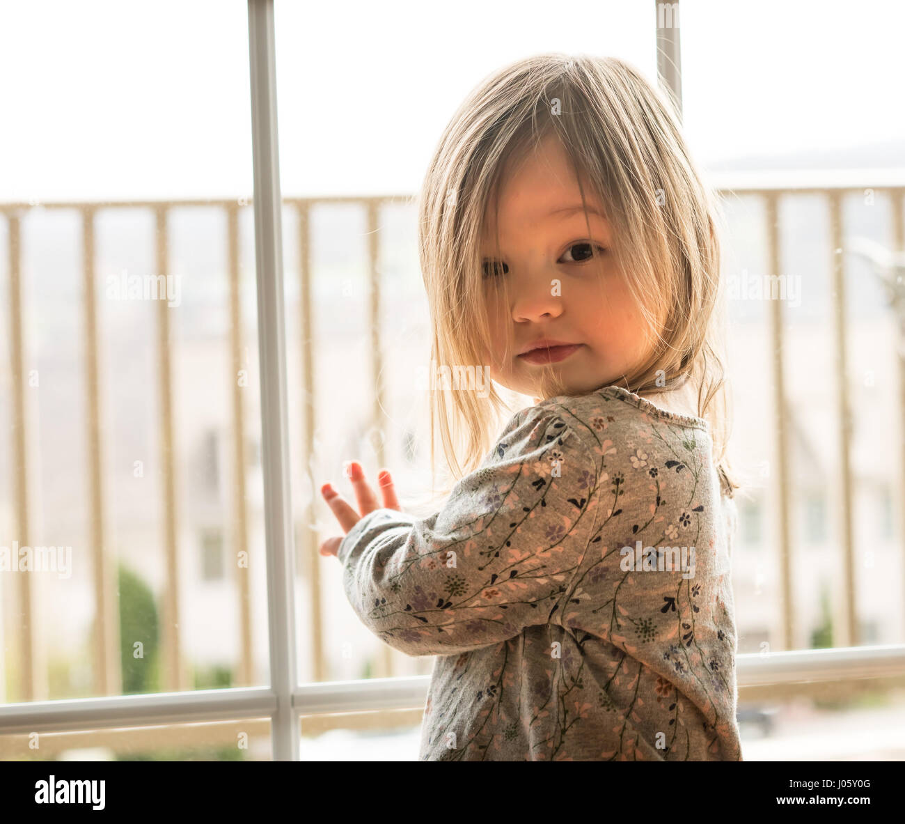 Young caucasian baby girl with adoring look - Stock Image