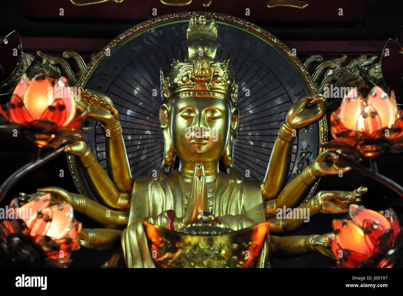 HANOI, VIETNAM - FEBRUARY 19, 2013: Small shrine devoted to Avalokitesvara Boddhisatva inside the One Pillar Pagoda Stock Photo