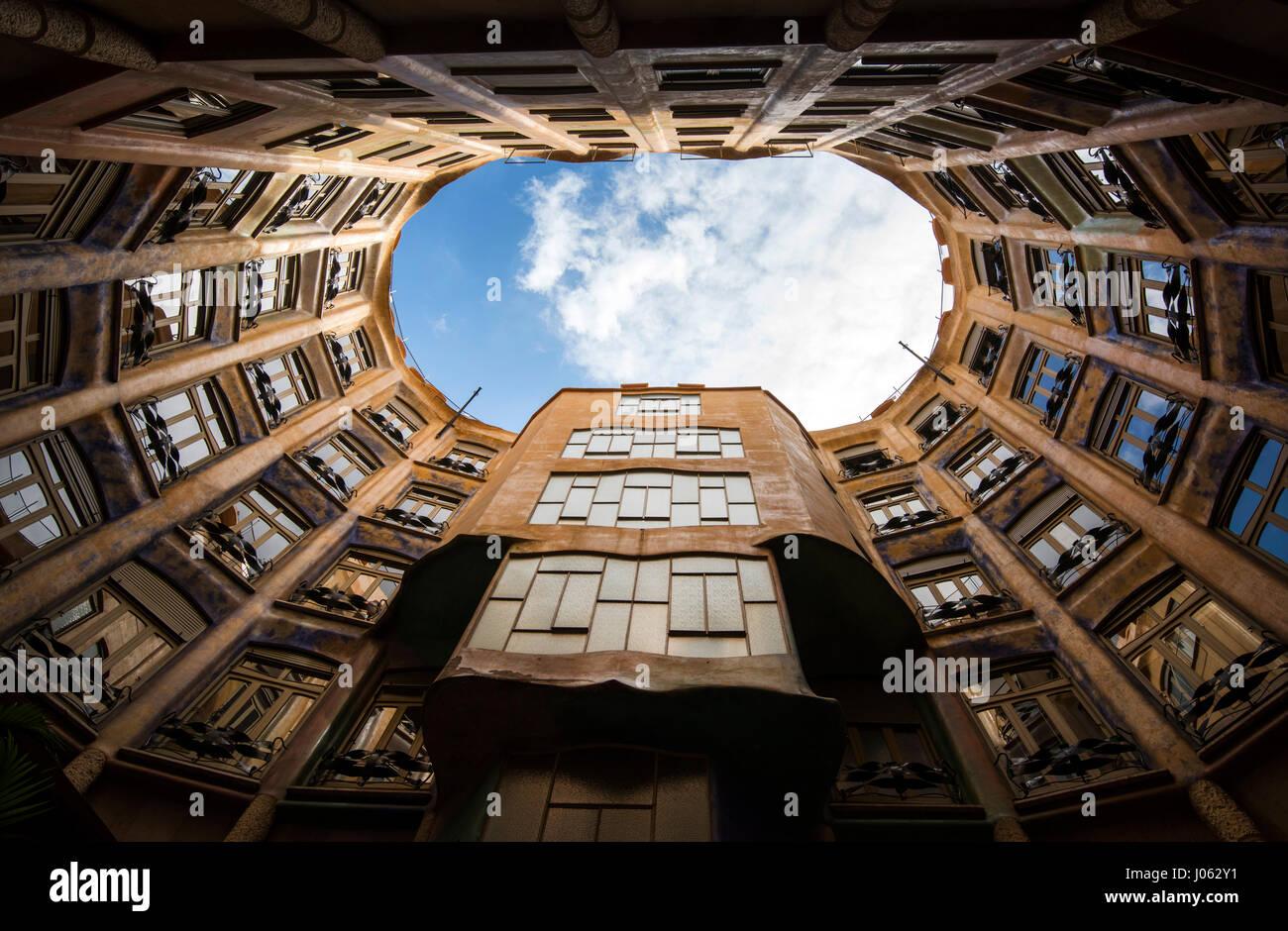 Looking up from an inner courtyard inside Casa Mila (La Pedrera) in Barcelona, Spain Europe EU - Stock Image