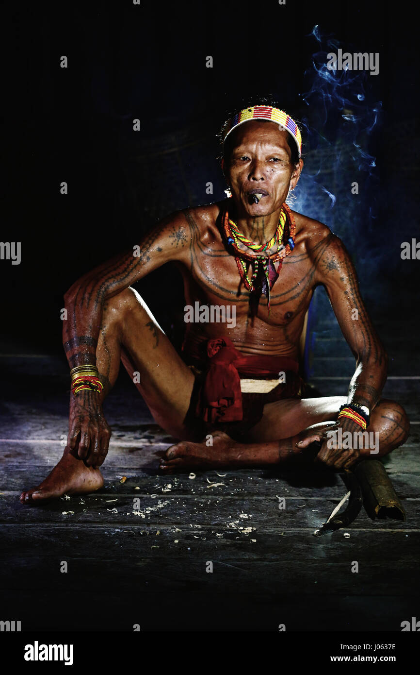 SIBERUT ISLAND, INDONESIA: MAGNIFICENT photographs of the last members of a tattooed tribe give an insight into - Stock Image