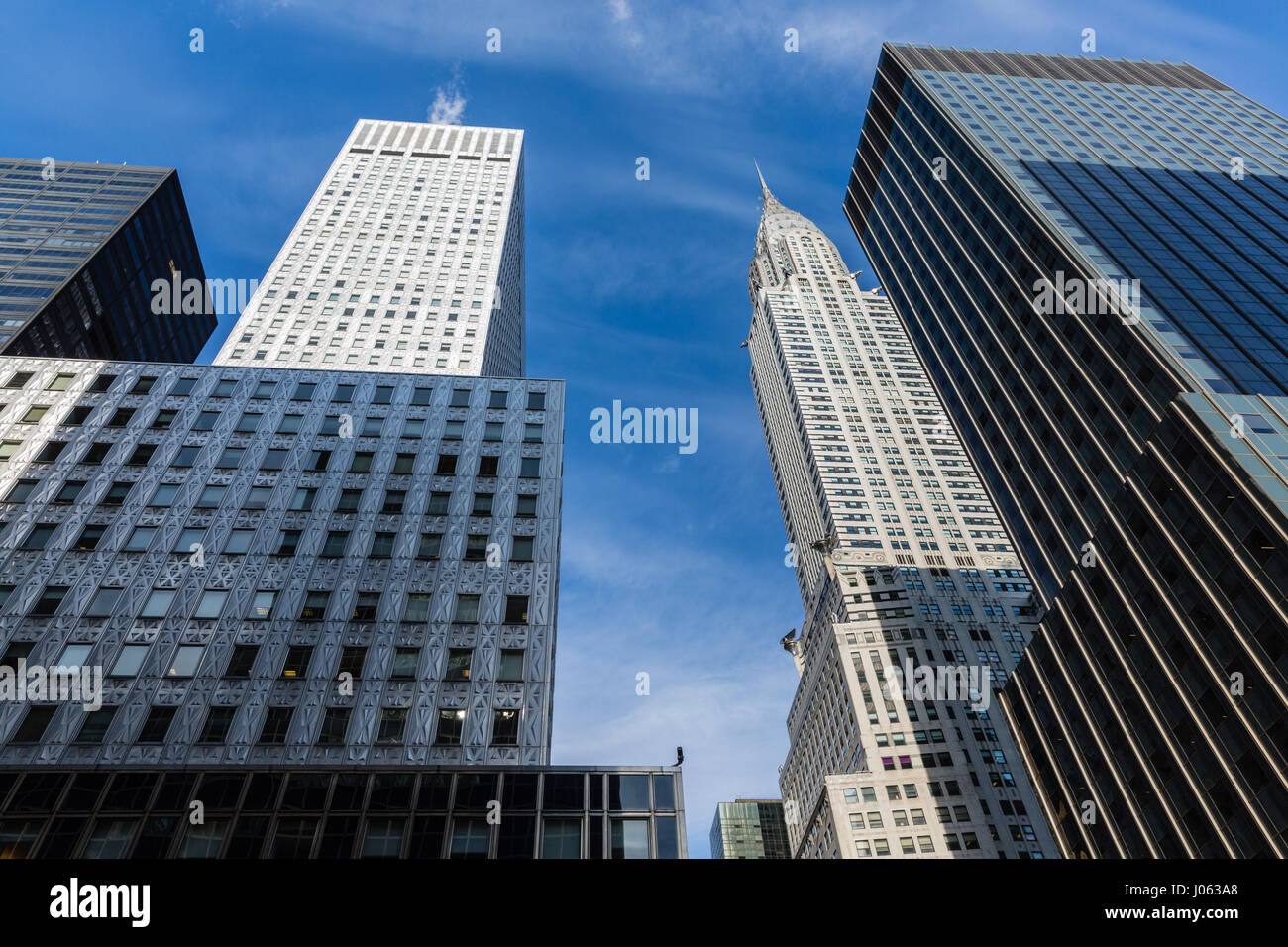 New York Skyline with sky scrapers and Chrysler Building - Stock Image